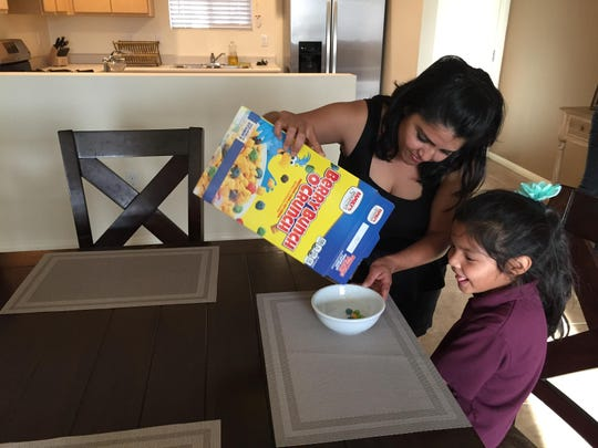 Graciela Gamboa and her daughter Evelyn Gamboa enjoy their new home at the Jardines housing development in Coachella. The houses were part of the Coachella Valley Housing Coalition new 205 homes.