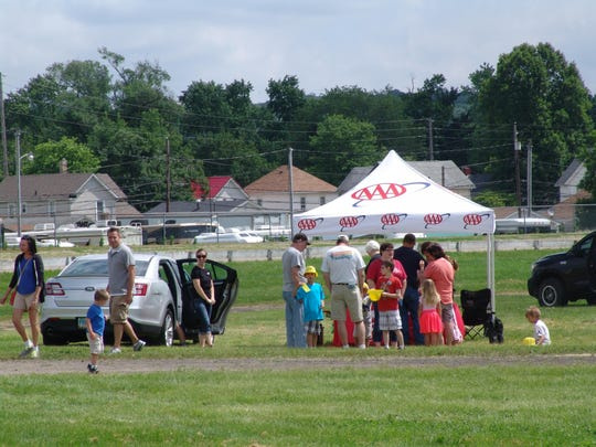 Attendees of the Coshocton Hot Air Balloon Festival gather around the AAA tent for Safety Saturday.