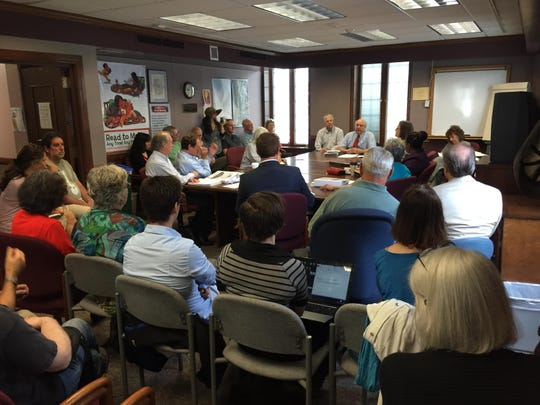 More than 20 people attended the meeting, and about 10 Tompkins County residents spoke before the vote.