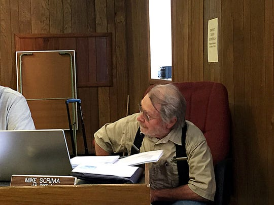 Justice Mike Scrima waits for an answer.