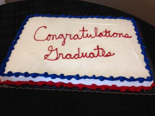 A congratulatory cake marks the end of a long journey for Sobriety Court graduates.