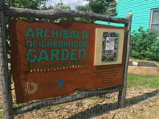 City officials and community gardeners Friday celebrated the grand reopening of the Archibald Neighborhood Garden on Thursday, June 11, 2015. The garden has raised garden beds for 24 neighbors.