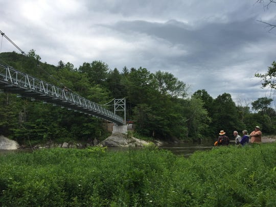 The Green Mountain Club celebrated the grand opening of a 224-foot Long Trail suspension bridge. The bridge, located off of U.S. in Bolton, has been a mission of the club since legislation was passed in 1912 to build a bridge over the Winooski River.
