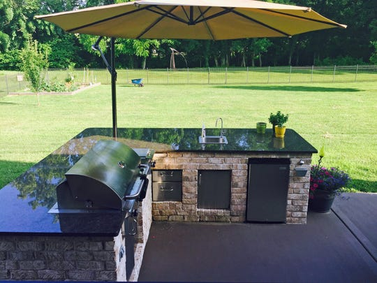Kris Whitt of Rutherford County blends antique and new decor to create a comfortable atmosphere on her outdoor patio kitchen, perfect for entertaining guests during the summer months.