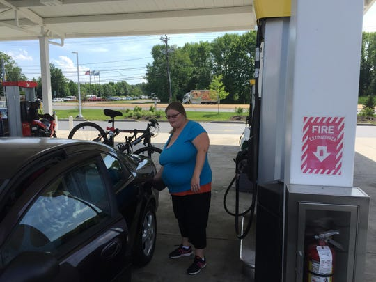 Barbara Mullens pumps gas at the Wawa store near the Del. 141 and I-95 interchange Friday. She worries that upcoming construction could cause more crashes.