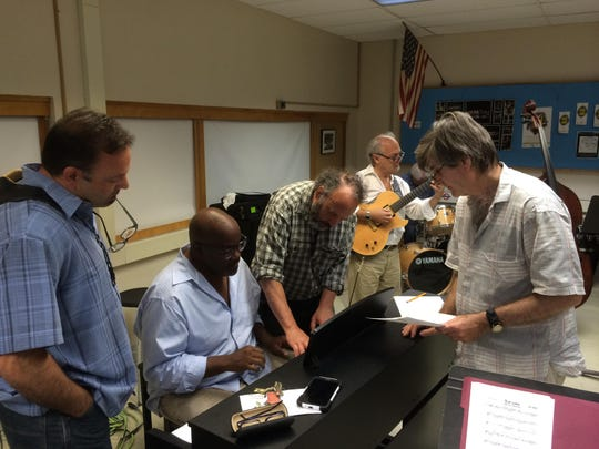 Sneakers Jazz Band members, left to right, Russell Remington, Joey Sommerville, Bruce Sklar, Paul Asbell and Clyde Stats work at a rehearsal Saturday at South Burlington High School.