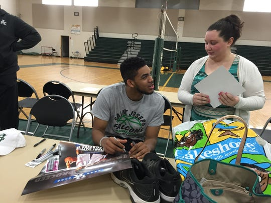 Karl-Anthony Towns signs autographs during an appearance at St. Joseph H.S. last month.