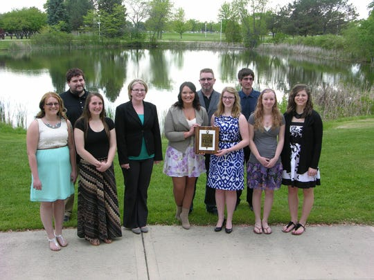 UW-Fond du Lac recently inducted new student members into the Phi Theta Kappa (PTK) National Honor Society. The mission of PTK is to recognize and encourage the academic achievements of two-year college students and provide opportunities for individual growth and development. Several current and new PTK members gathered after the ceremony. Pictured front row, from left: Shannon McCabe, Olivia Petrie, Rebecca Rate, Nicole Mader, Kalila Master, Jordan Stortz and Alyssa Harmsen. Back row, from left: Nicholas Johannes, Deryl McCauley and Marshall Bennett. Not pictured are new inductees: Mourad Al-Tahrawy, Melina Roeder, Ryan Shierling and Robyn Voge. New members of PTK presented Golden Apple awards during the ceremony in appreciation for excellence in teaching to Jeff Carew, David Demezas, Richard Gustin, Richard Klein, Yanting Liang, Alayne Peterson, Jennifer Schultz and Kristi Wilkum.