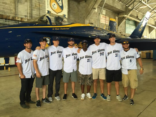 Several of the Pensacola Blue Wahoos players inside the hangar for the Blue Angels prior to the team's trip on Fat Albert Tuesday at Pensacola Naval Air Station.