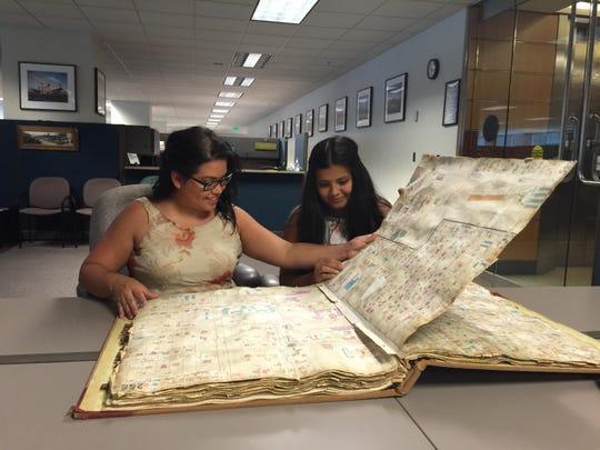 DeAnna Trevino and CyAnna Martinez study the Sanborn Insurance maps.
