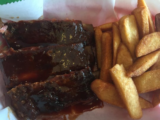 An order of ribs and fries at Smoke-In D's BBQ.