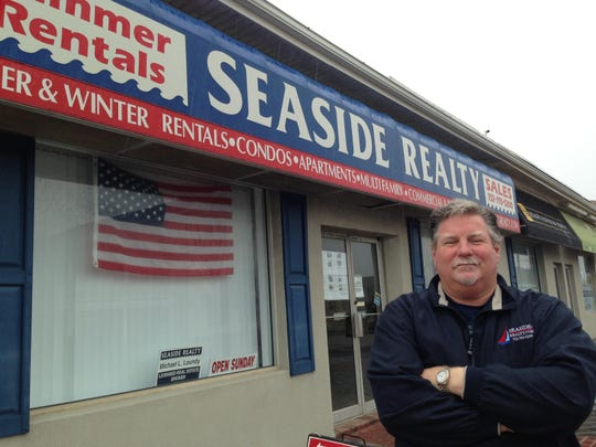 Michael Loundy in front of his Seaside Reality in Seaside