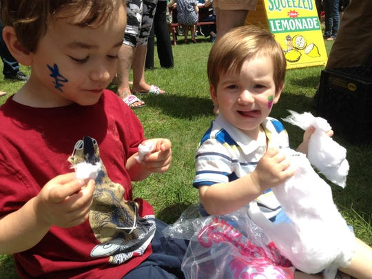Calvin Ehle, 5, and Bennett Ehle, 2, of Colchester eat maple cotton candy Saturday at Mazza's Strawberry Festival in Colchester.