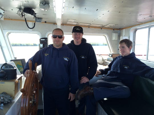 Captain of the Washington, Joe Gunnlaugsson, and deck hands Christian and Doug Foss in the ferry's control room before docking at Detroit Harbor in early June.