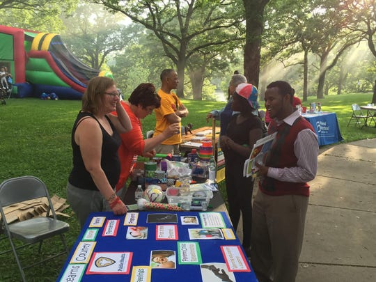 St. Cloud residents interact Friday with volunteers from the Stearns County Public Health Department, one of many community organizations represented at the Juneteenth celebration. Juneteenth is honored every year on June 19th to mark the end of slavery in the United States.