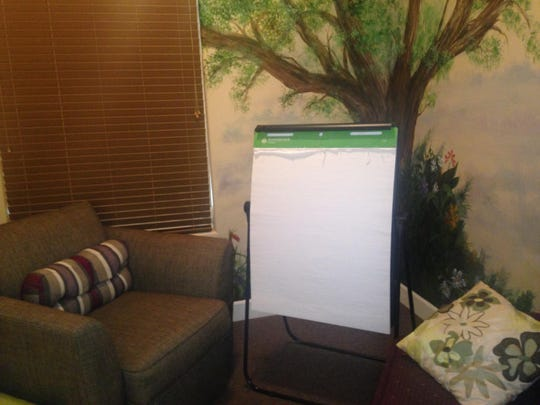 An interview room at the Children's Justice Center presents a comfortable atmosphere for abused children to talk about their experiences, but includes a large white drawing pad used in the interview when words aren't adequate for the youngsters.