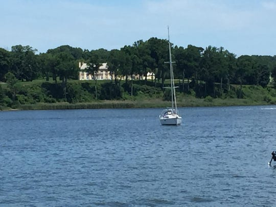 Bon Jovi's home can be seen through the trees on the Middletown side of the Navesink River.