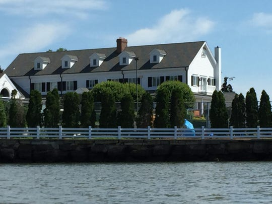 A compound with tennis courts sits on the Middletown side of the Navesink River.