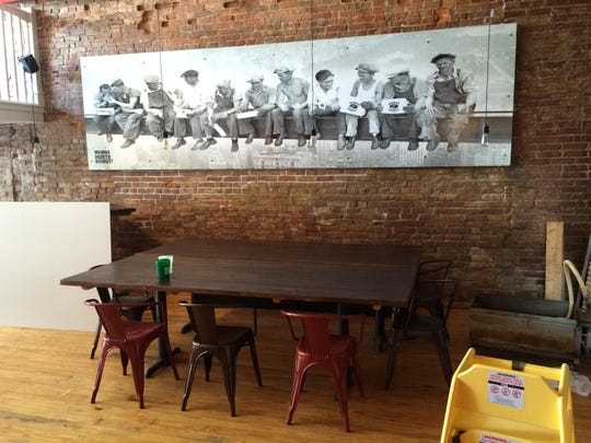 Hurts Donut Company has large tables for meetings and study groups inside its downtown Springfield location as shown in this 2015 News-Leader file photo.