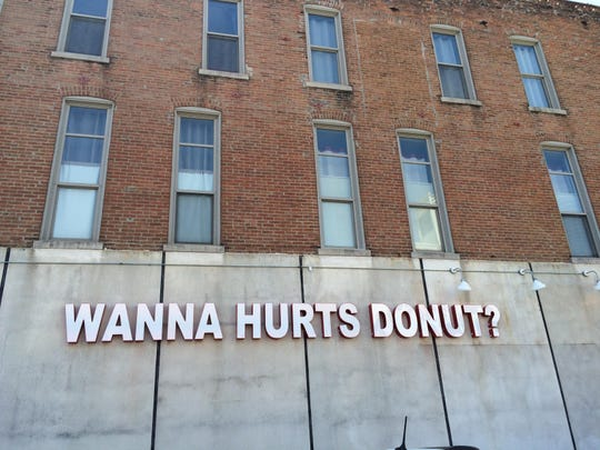 Hurts Donut Company's downtown Springfield location at 320 Park Central West sports a big sign on its east side as shown in this 2015 News-Leader file photo.