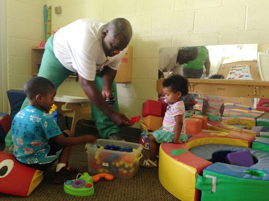 Town of Cheneyville Alderman Charles Allen (center) plays with Za'Nyrian Richard (left), 4, and Brooklyn Taylor, 1, at the Derboune Head Start Center in Cheneyville. Allen said the center is set to close after July. He has begun a petition to prevent its closure.