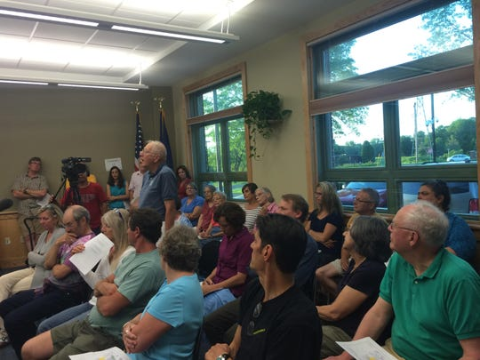 "Chuck Vile, the Essex forester, tells residents that he is tired of the argument over the Saxon Hill Forest. ""Make this deal, run with the deal and come on let's get on and take care of that land,"" he said at a hearing Monday night."