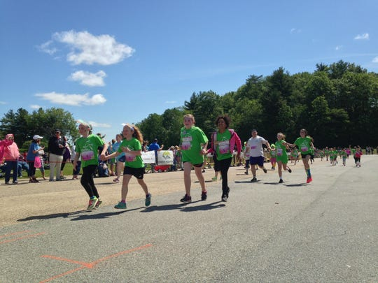 Girls head to the finish line at the 5K event in Essex Junction.