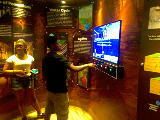 In addition to free swimming on Fridays, arts and crafts and instructional classes, teens in the city's free Summer Youth Program enjoy weekly field trips. The group from Moore, including Malaysia McLaughlin, left, and Lucius Brown, take in exhibits in Dunbar Cave's Visitors' Center, the most recent of the site's field trips.