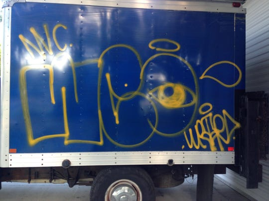 Employees at Nancy's Haute Affairs discovered this graffiti tag on several company vehicles Sunday morning.