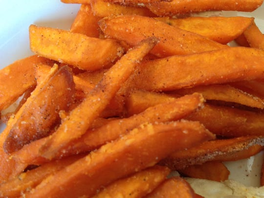 Sweet potato fries are crisp and dusted with a bit of sugar and spice.