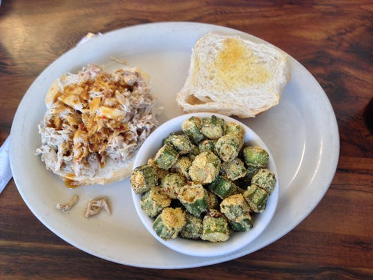 The slow-smoked, chopped turkey is smoky and tender, while the fried okra is crisp and peppery.