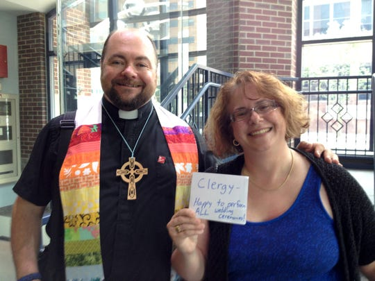 Reverends Greg Briggs and Naomi Zikmund-Fisher were ready to marry couples at the Washtenaw County Courthouse.