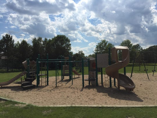 A playground apparatus at Kiwanis Park features multiple