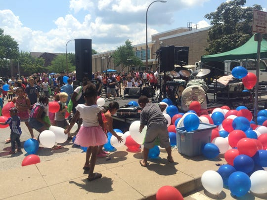 Kids collect balloons at the Juneteenth Celebration on Saturday, June 27, 2015, at the Robert A. Lee Recreation Center in Iowa City.