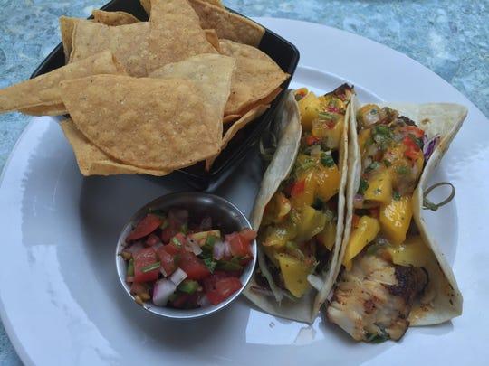 Fish tacos from the Wild River Grille lunch menu feature blackened mahi mahi, mango salsa, pico de gallo and cilantro crema.