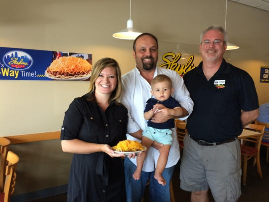 Gates Rodenfels, right, owns the Fort Myers and Naples Skyline Chili locations with E.B. and Tag Yarnell, shown here with their young son, and a plate of Skyline's 5-Way chili.