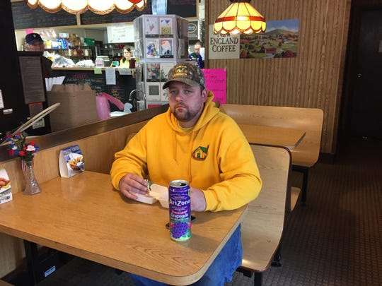 Mike O'Brien of Essex has a soft drink with lunch Wednesday at Kerry's Kwik Stop in Burlington. Wednesday was the first day of a new 6-percent sales tax on soft drinks.