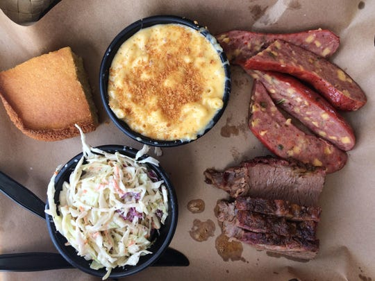 A 2 Meat XXL Combo from Mission BBQ with lean brisket, jalapeno-cheddar sausage, macaroni and cheese, coleslaw and cornbread.