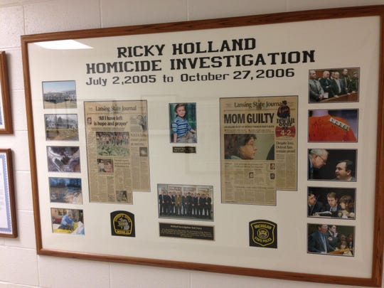 This display at the Ingham County Sheriff's Office pays tribute to Ricky Holland, and the investigators who solved his murder.