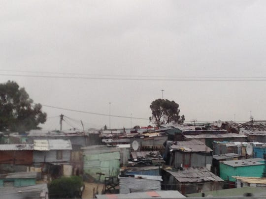 The corrugated steel shacks in the townships outside of the modern city of Cape Town, South Africa.