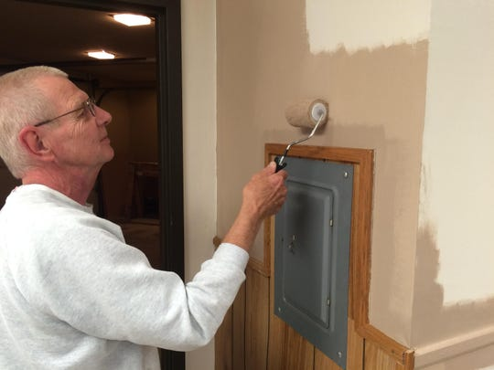 Marshfield Area Pet Shelter volunteer Bob Kuehl paints a wall Thursday at the shelter's temporary location, 210 W. 29th St.
