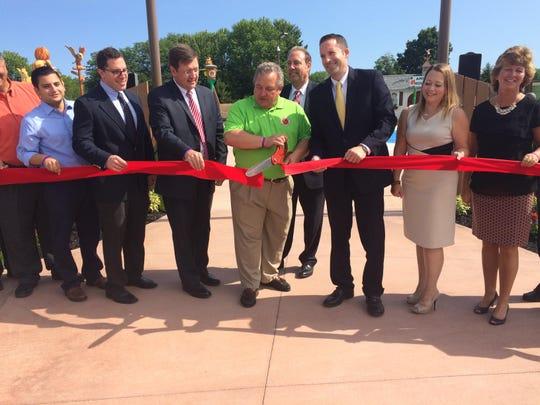 "Greece Town Supervisor Bill Reilich declares the ""Wild Over Water"" splash park open as public officials lend their support."