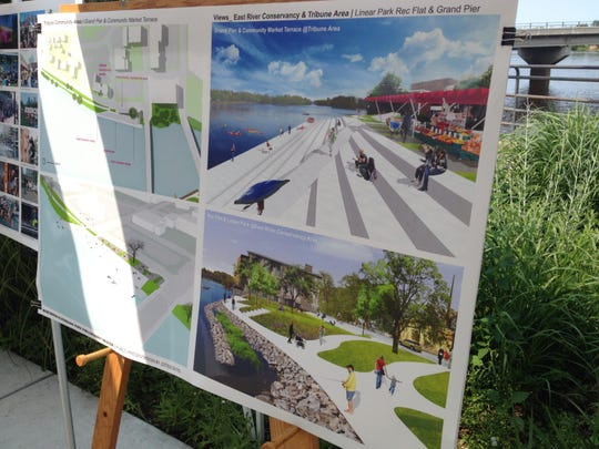 A posterboard showing the proposed plans for Linear Park (bottom right) and the riverfront area in front of the old Daily Tribune building (top right).