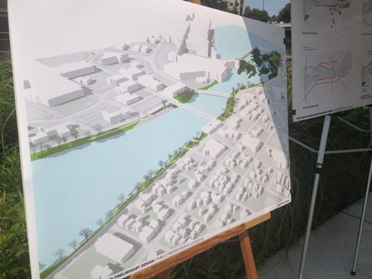 A posterboard showing the riverfront areas that would receive enhancement.