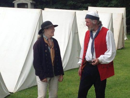 Peggy Huckel chats with John McMorland outside the encampment at St. Anne's Shrine.