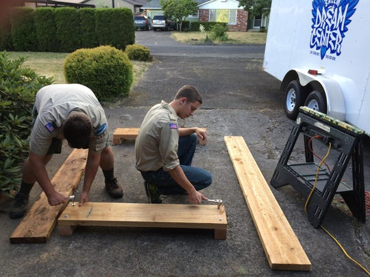 Volunteers from a local Boy Scout troop construct raised garden beds for the community garden at Nuestra Casa.
