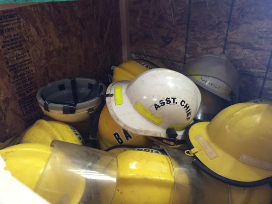 Old Southern Door Fire Department helmets inside one of the crates built by the Southern Door Fire Department to donate gear to the International Fire Relief Mission.