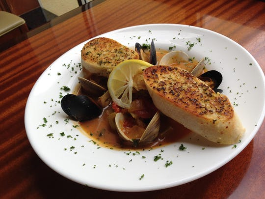 The bouillabaisse, topped with toasted garlic bread, at The Prawnbroker in Fort Myers.
