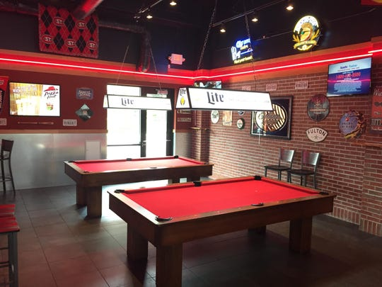 Pool tables at the new St. Cloud Pizza Hut.