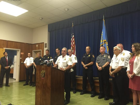 Brockport's Daniel Varrenti, President of the Monroe County Chiefs of Police Assocaiation, flanked by the other chiefs to call for parole reform in a press conference at Gates Town Hall on July 9, 2015.
